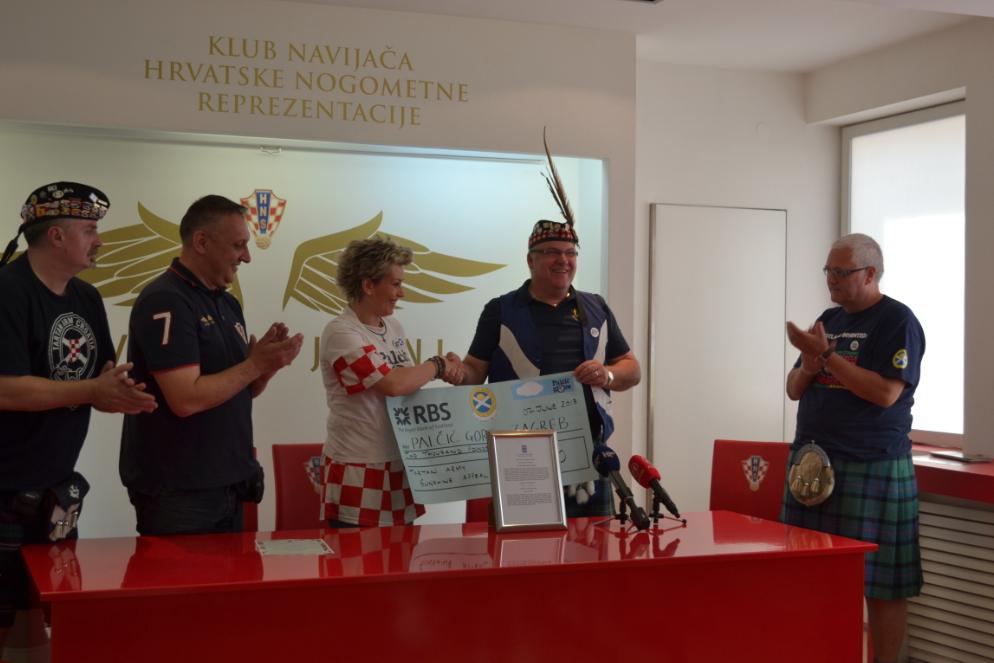 Neil Forbes of the Tartan Army Sunshine Appeal presents a cheque for £2000 to Željka Vučko of Palčić Gore