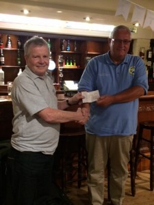 TASA chairman John Daly receives the cheque from Kelburn Brewery  MD, Derek Moore.